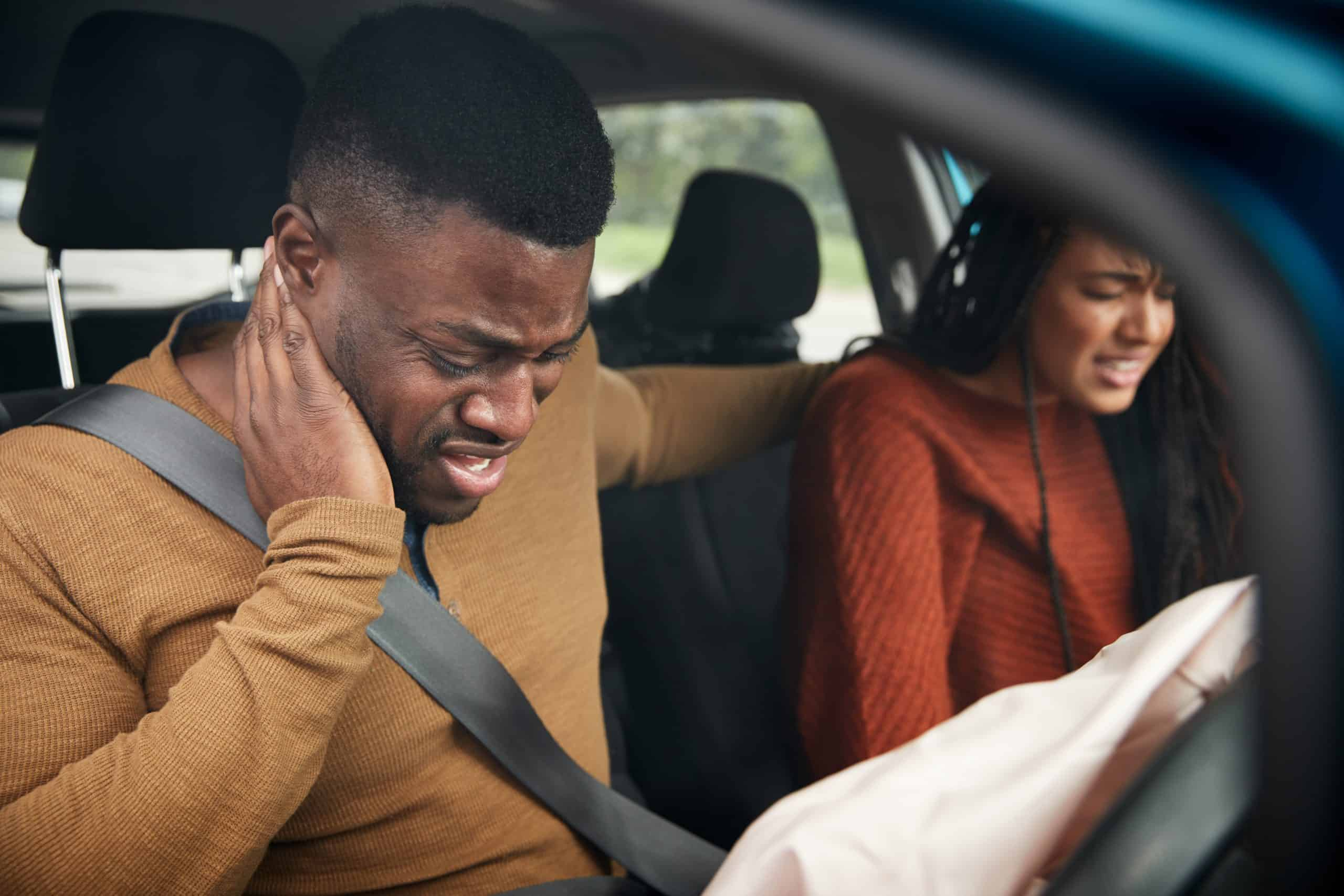 couple in car experiencing whiplash